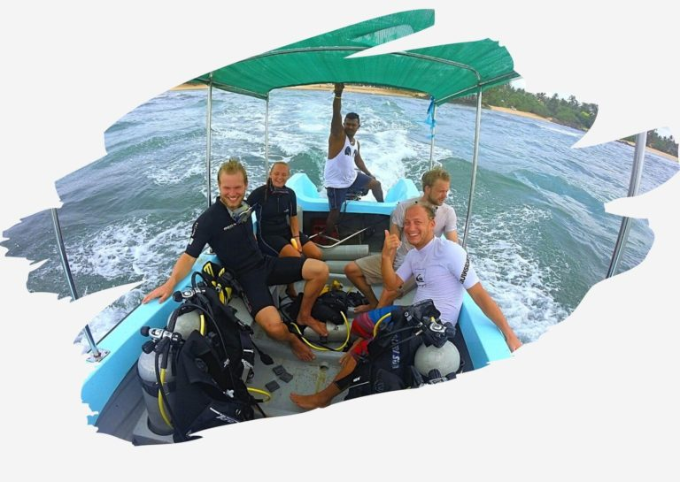 divers leaving on a boat